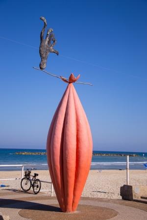 Statue of animal juggler lon a beach Stock Photo