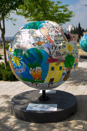 A globe statue  and some of the surroundings of Jerusalem Editorial
