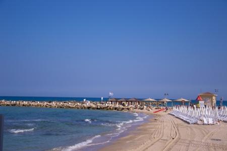 Beach umbrellas and sunbeds on the sand.Tel Aviv Stock Photo