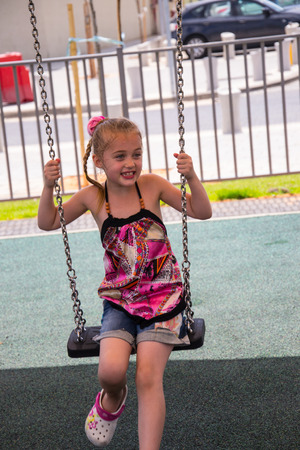 Adorable girl on a swing
