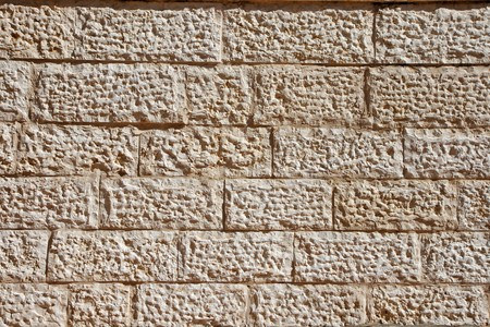 Wall built of Jerusalem stone blocks (limestone) Stock Photo