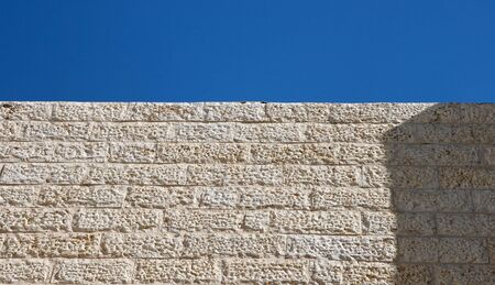 Upward view of vertical wall bilt of Jerusalem stone blocks Stock Photo