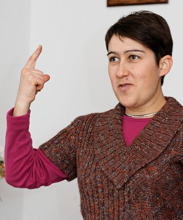 Young short-haired woman raising her finger Stock Photo - 4486029