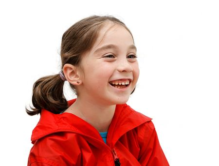 Laughing seven years girl with pigtails Stock Photo