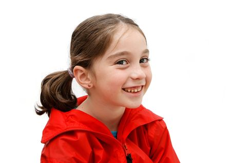 Smiling seven years girl with pigtails Stock Photo