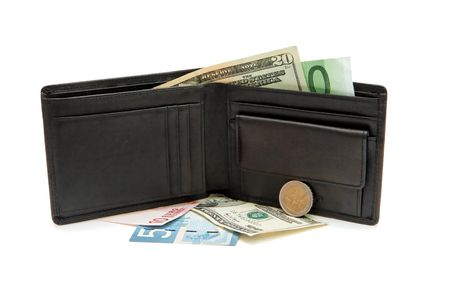 Black wallet, banknotes and coins on white background