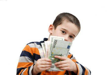 hides: Cute little boy hides behind a fan of banknotes