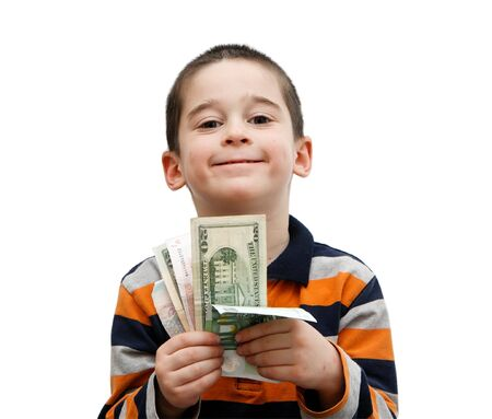 Cute little boy holds a fan of banknotes photo