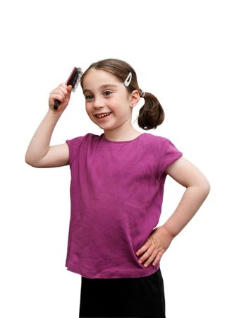 Cute seven years girl with pigtails brush her hair on white background photo