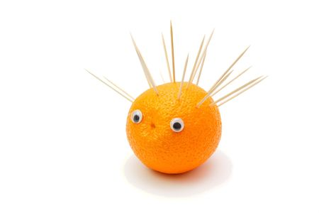 Funny hedgehog mage of orange fruit and toothpicks on white background Stock Photo