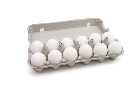 Twelve eggs in a paper box on white background