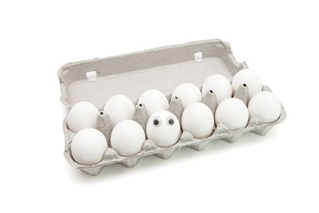 Funny egg with eyes among dozen in a paper box on white background Stock Photo - 4729628