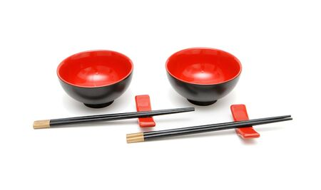 Two sets of chopsticks on stands and the red and black Japanese bowls Stock Photo - 4927628