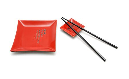 Chopsticks, red square plate and red saucer isolated Stock Photo - 4927624