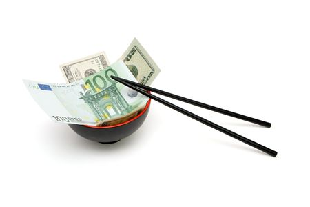 Money in red and black oriental bowl  with chopsticks isolated photo