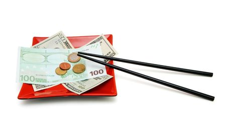 Money bills and coins on red square plate with chopsticks isolated photo