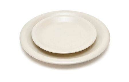 Plain beige dinner plate and  saucer isolated photo