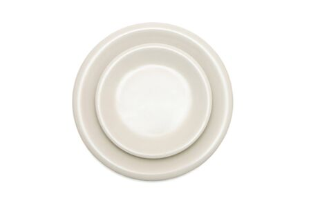 Plain beige dinner plate and  saucer isolated top view