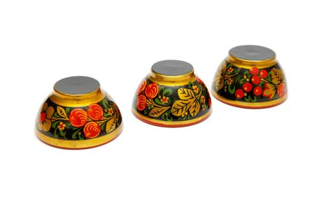 Three painted Russian khokhloma cups upside down isolated Stock Photo