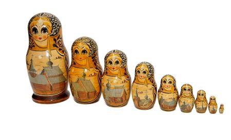 Russian Babushka nesting dolls painted as nuns of Kizhi monastery isolated