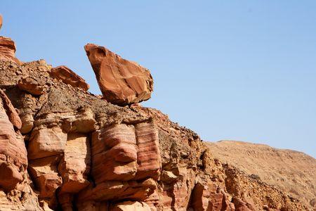 unstable: Picturesque unstable red rock in Negev desert, Israel Stock Photo