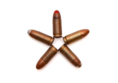 Five-pointed star made of 9mm Parabellum cartridges isolated photo