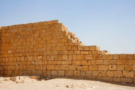 Broken wall of ancient temple ruin photo