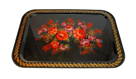 Old russian folk hand-painted black metal tray with floral pattern isolated photo