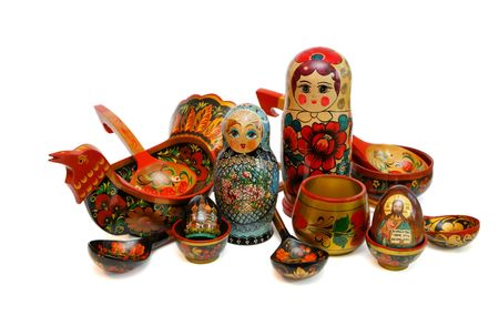 Assorted Russian wooden toys, kitchen utensils and religious objects isolated photo