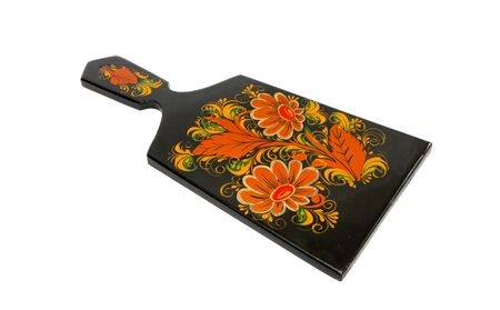Russian black cutting board painted with flowers isolated photo