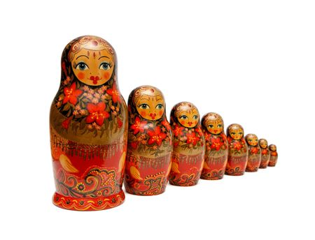 nesting: Row of Russian Babushka nesting dolls isolated Stock Photo