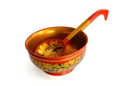 Russian wooden painted bowl with ladle isolated photo