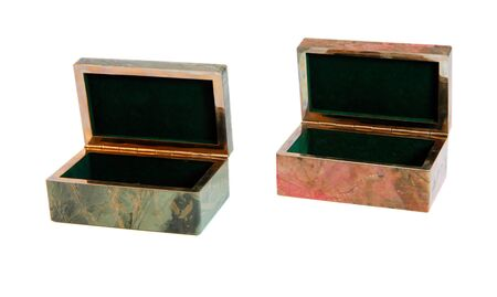 Jasper and rhodonite stone caskets isolated on white background photo