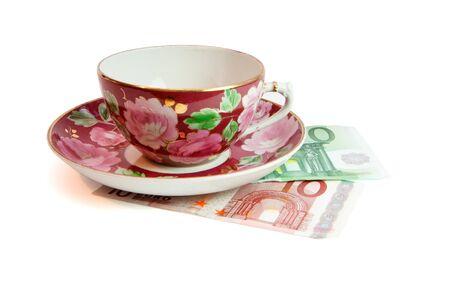 Tea service on euro banknotes isolated  photo