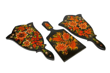 Three Russian black cutting board painted with flowers isolated photo