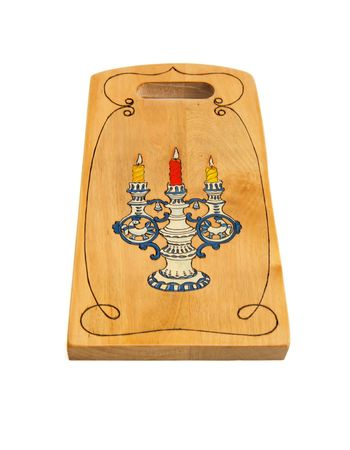 Wooden cutting board painted with candlestick isolated Stock Photo