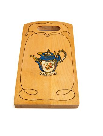 Wooden cutting board painted with teapot isolated Stock Photo