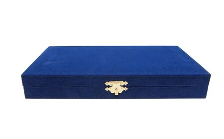 Closed dark blue velvet casket with golden lock isolated
