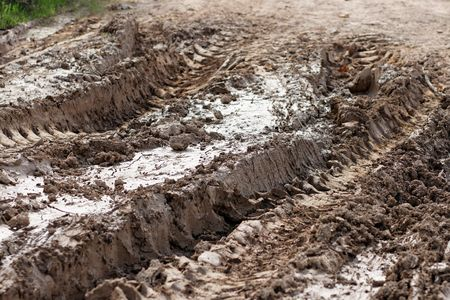 Closeup of car ruts in dry road mud  Stock Photo - 5168351