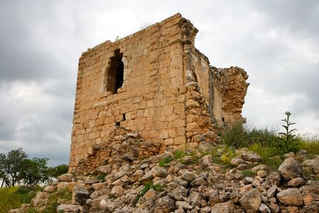 crusader: Ruins of medieval Crusader castle in cloudy day