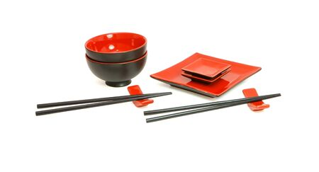 Red and black sushi service for two isolated photo