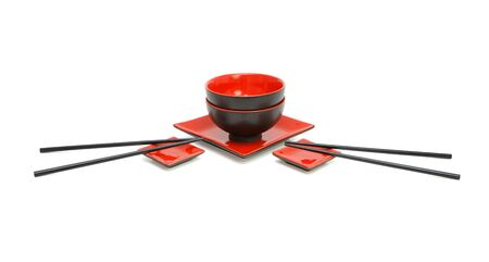 Red and black Japanese service for two isolated photo