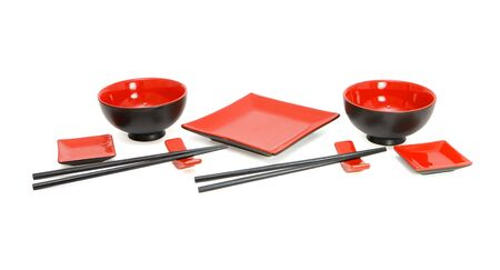 Japanese red and black sushi service for two isolated photo