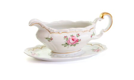 Vintage porcelain sauce-boat isolated on white background