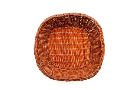 Brown wicker basket top view isolated on white background photo