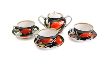 Black tea service consisting of three cups and sugar basin isolated  photo