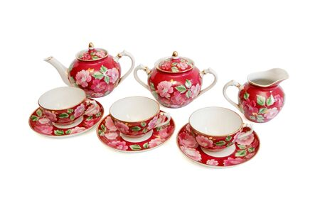 Beautiful red tea service isolated on white background photo