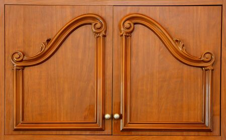 closet door: Wooden carved wardrobe doors closeup Stock Photo