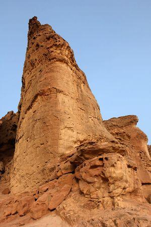 Triangular sandstone rock in the desert in Timna national park in Israel photo