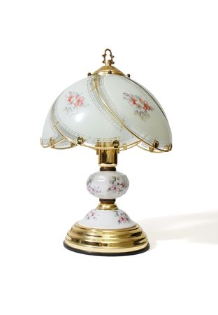 Table lamp under the glass lampshade with flower pattern isolated